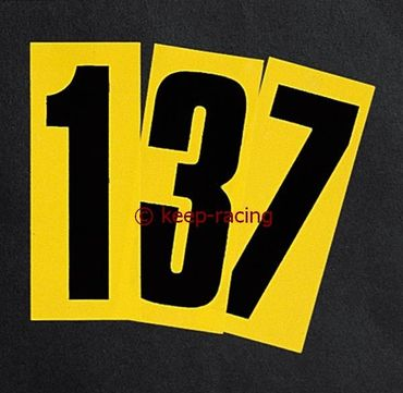 black adhesive number 7, with yellow background