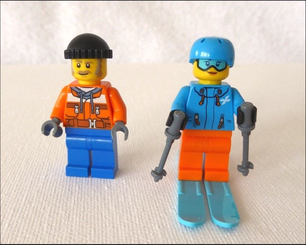 Skifahrer und Raupenfahrer