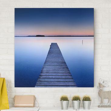 Produktfoto Leinwandbild - Flußsteg bei Sonnenuntergang - Quadrat 1:1, vergrößerte Ansicht in Wohnambiente, Artikelnummer 206420-XWA