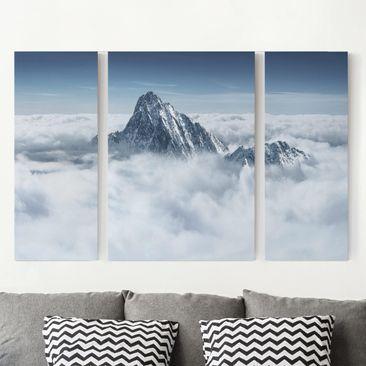 Produktfoto Leinwandbild 3-teilig - Die Alpen über den Wolken - Triptychon, vergrößerte Ansicht in Wohnambiente, Artikelnummer 213276-XWA
