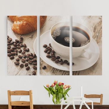 Produktfoto Leinwandbild 3-teilig - Dampfende Kaffeetasse mit Kaffeebohnen - Hoch 2:1 , vergrößerte Ansicht in Wohnambiente, Artikelnummer 216255-XWA