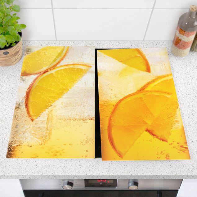 Produktfoto Herdabdeckplatte Glas - Orange auf Eis - 52x60cm, vergrößerte Ansicht in Wohnambiente, Artikelnummer 227919-XWA