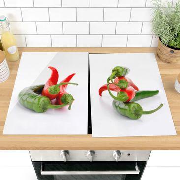 Produktfoto Herdabdeckplatte Glas - Rote und grüne Peperoni - 52x80cm, vergrößerte Ansicht in Wohnambiente, Artikelnummer -XWA