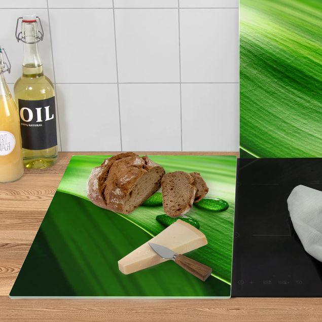 Produktfoto Herdabdeckplatte Glas - Bananenblatt mit Tropfen - 52x80cm, Anwendungsbeispiel, Artikelnummer -XWAF
