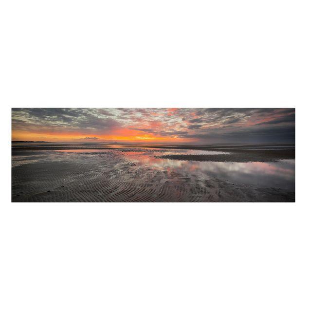 Produktfoto Leinwandbild - Sonnenaufgang im Watt - Panorama 1:3