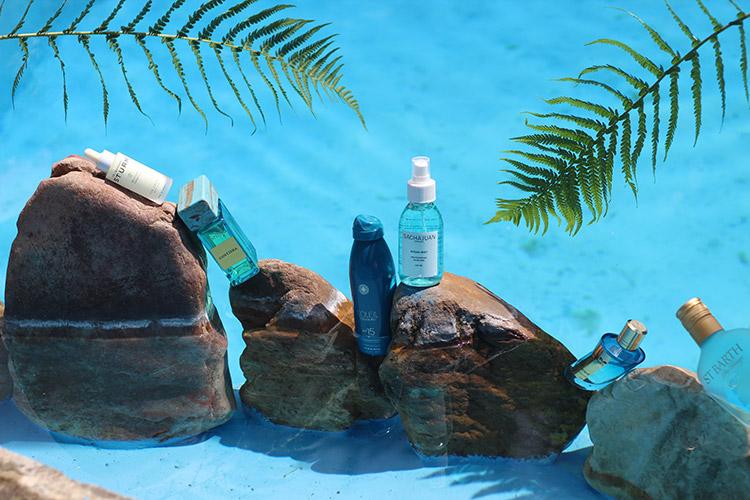 pflegeprodukte auf steine im wasser