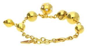 Guess Damen Armband Metall Gold Sparkle Sphere UBB31310