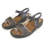 Naot Damen Schuhe Sandaletten Birgitta Leder schwarz gold metallic 13800 001