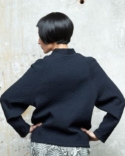 V-KNECK MERINO JUMPER (ABSTRACT HERRINGBONE KNIT) – image 1