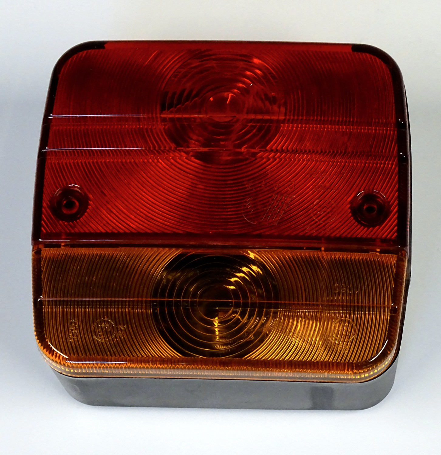 Back light with integrated number-plate light right and left applicable 104 x 95 mm