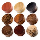 Concave Ear Plugs made of different woods