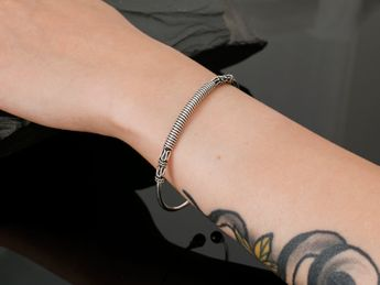Artfully forged silver bangles in various elegant antique designs – picture 10