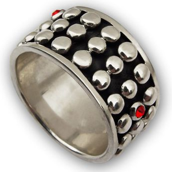 Heavy silver ring in medieval design with red zirconia crystals