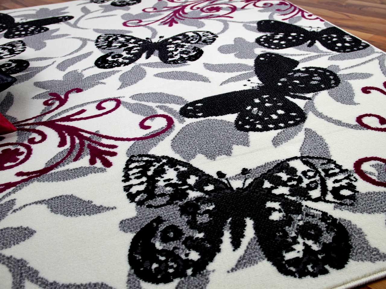 teppich trendline butterfly schwarz pink in 4 gr en teppiche designerteppiche trendline teppiche. Black Bedroom Furniture Sets. Home Design Ideas