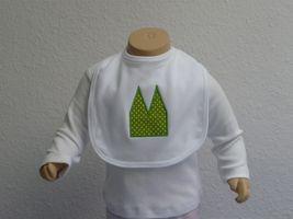 Weißes Lätzchen mit grüner Dom Applikation