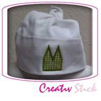 weiße Baby-Mütze mit grüner Dom Applikation