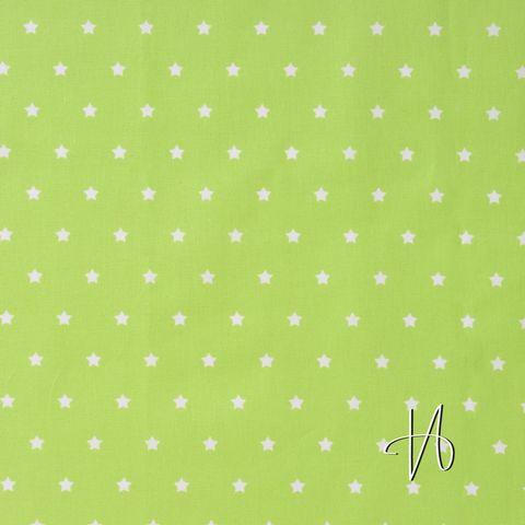 Wachstuch aus beschichteter Baumwolle mit weißen Sternen auf hellgrün