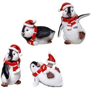 Weihnachten - 4er Set spielende Weihnachts Pinguine 10cm