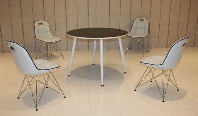 Tischgruppe im Stil der fünfziger Jahre - Esstisch rund schwarz/weiß und 4 Stühle weiß/schwarz