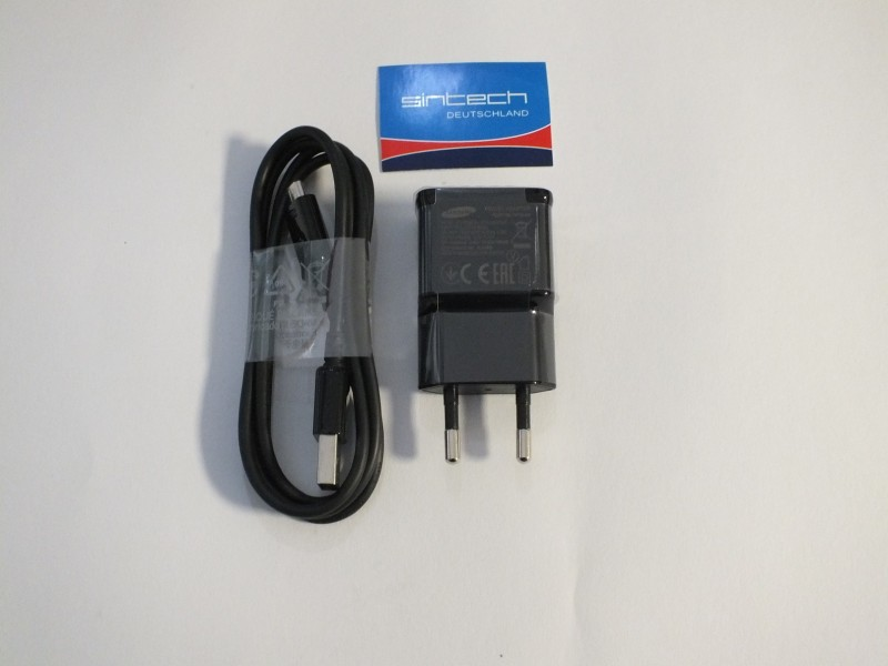 Original Samsung travelcharger, for all Samsung mobilphones with micro-USB ETA-U90EBE incl.cable
